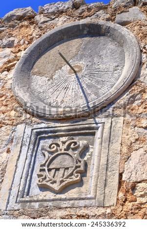 Round dial of a solar clock on a Venetian building from Dalmatian coast, Croatia - stock photo