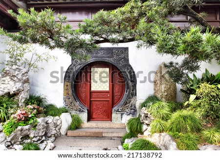 Round doorway in ancient Yu Yuan Garden in Shanghai, China - stock photo