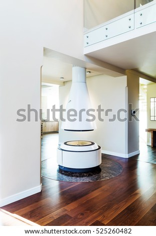 round fireplace in living room of a house