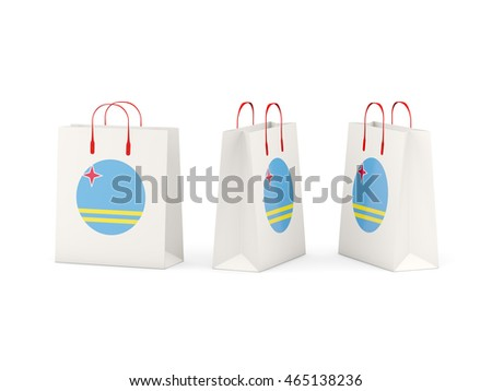 Round flag of aruba on shopping bags. 3D illustration