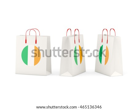 Round flag of ireland on shopping bags. 3D illustration