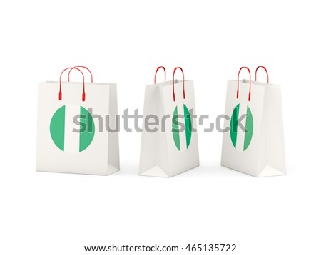 Round flag of nigeria on shopping bags. 3D illustration