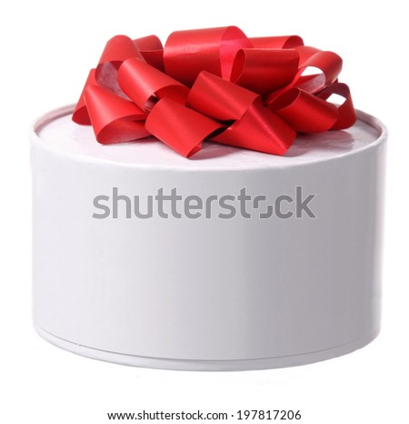 round gift box with red ribbon bow - stock photo