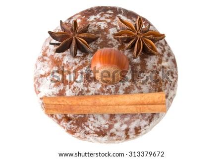 Round gingerbread with face of baking ingredients - stock photo
