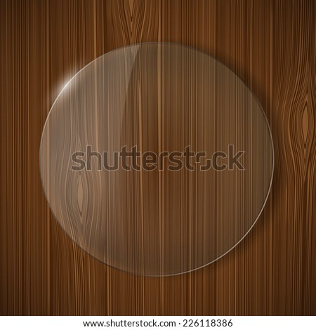 round glass frame on a wooden background - stock photo