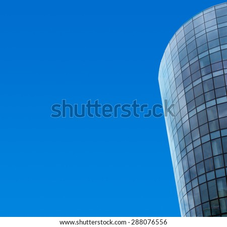 round glass multistory building blue sky background - stock photo