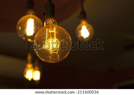 round glowing tungsten lamps - stock photo