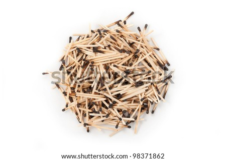 Round heap of burnt matches. On a white background - stock photo