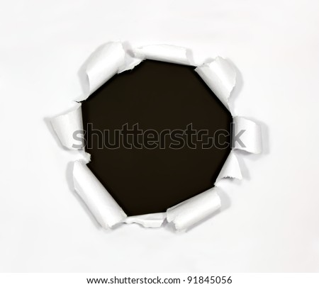 Round hole in paper on black background inside - stock photo