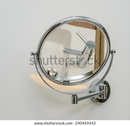 Round mirror in the bathroom. Photo for microstock - stock photo