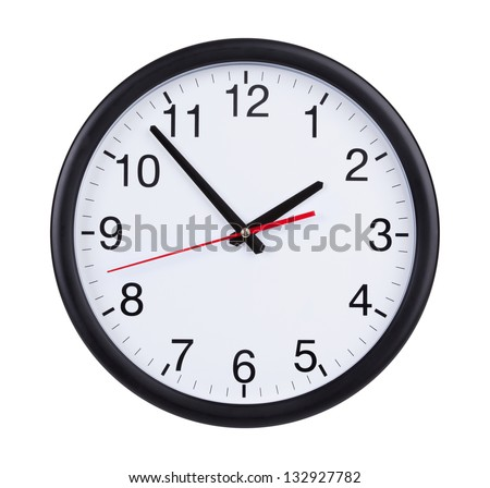 Round office clock shows five minutes to two - stock photo