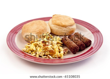 round plate of breakfast biscuits, scrambled eggs, and sausage links - stock photo