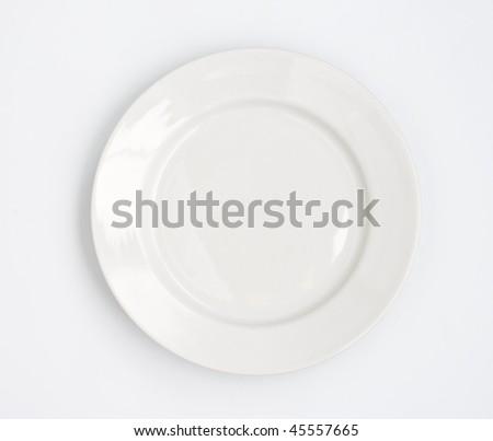 Round plate on white background - stock photo