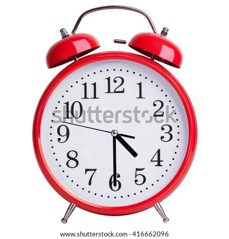Round red alarm clock shows half past four - stock photo