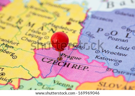 Round red thumb tack pinched through city of Prague on Czech Republic map. Part of collection covering all major capitals of Europe. - stock photo