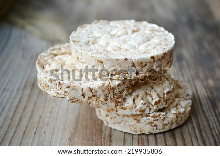 Round rice cakes on wooden table - stock photo