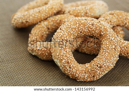 Round rusks with sesame seeds, closeup picture.