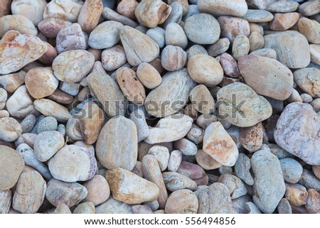 Round sea rock on the beach, nautural background