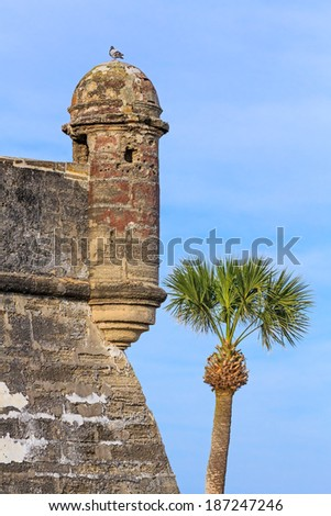 Round sentry boxes or turrets (garitas) overhang the corners of the bastions of the Castillo de San Marcos, a centuries old Spanish fort in St. Augustine, Florida. This is the San Augustin Bastion. - stock photo