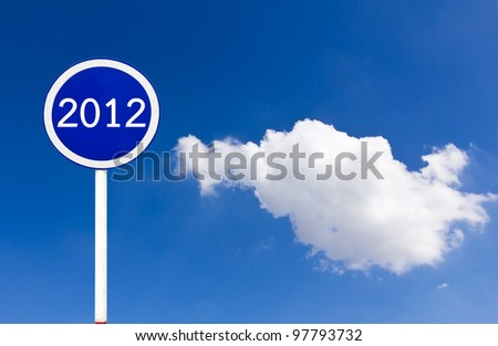 Round sign 2012 New Year concept on blue sky