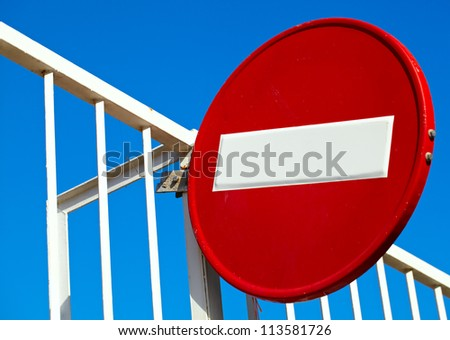 Round sign No Entry on blue sky background - stock photo