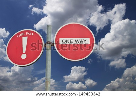 Round sign No Entry or one way - sky on background - stock photo