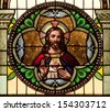 Round stained glass window depicting Sacred Heart of Jesus - stock photo