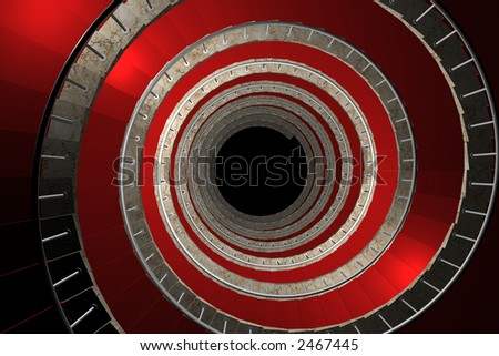 Round stairway of marble and covered with red carpet