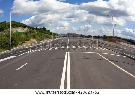 Round street in empty town. Blue sky and white cloud. Wide angle - stock photo