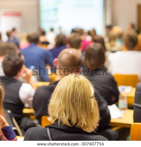 Round table discussion at business and entrepreneurship workshop. Audience at the conference hall. Presentation in lecture hall at university. Participants listening to lecture and making notes. - stock photo