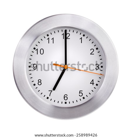 Round the clock shows exactly seven o'clock - stock photo