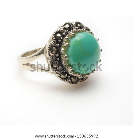 Round turquoise cabochon ring isolated on white background - stock photo