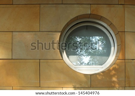 round vintage window on a marble wall  - stock photo