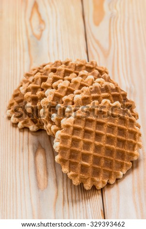 Round wafers on a wooden table. - stock photo