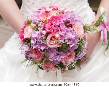 round wedding bouquet of pink flowers - stock photo