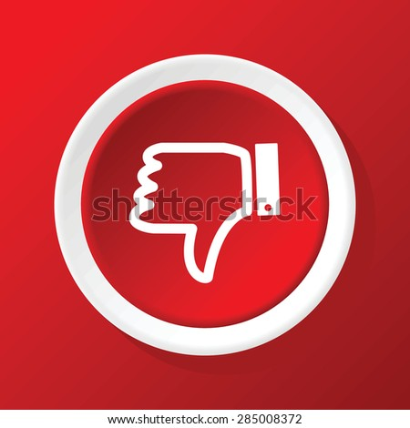 Round white icon with dislike symbol, on red background - stock photo