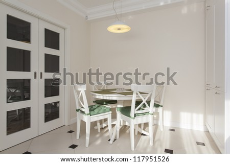 Round white table in bright and modern kitchen - stock photo