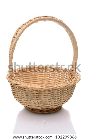 Round wicker basket with handle isolated on a white background with slight reflection.