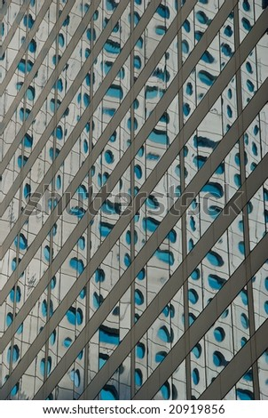 Round windows reflected in square windows in Hong Kong, China