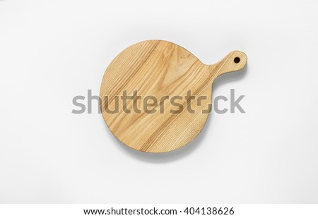 Round wooden cutting board on a white background - stock photo