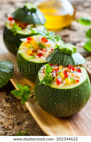Round zucchini stuffed with vegetables and rice - stock photo