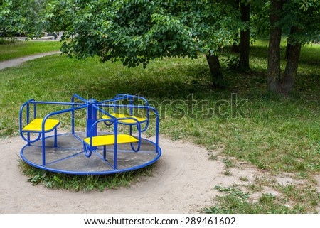 Roundabout in empty child playground - stock photo