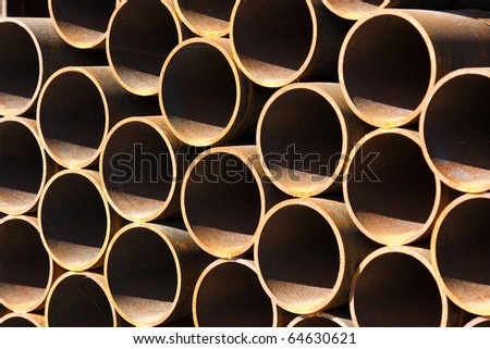 Rounded pipes metal stack - stock photo