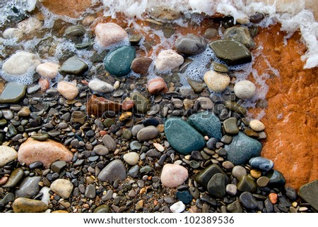 rounded stones on beach - stock photo