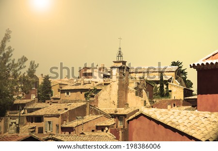 "Roussillon ocher village (included in the list of ""The most beautiful villages of France""). Provence Alpes Cote d'Azur, France. Aged photo. Sunlight. - stock photo"