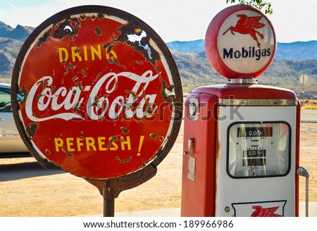 ROUTE 66, AZ, MAY 15: Retro gas pump and a rusty coca-cola sign on historic route 66 in Arizona on May 15, 2013 - stock photo