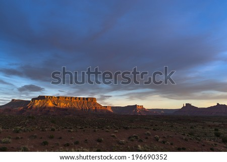 Route 128 Castle Valley near Moab Utah - colorful sunset  - stock photo