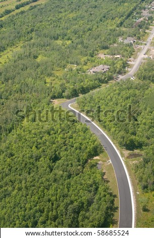 Route in the forest near Montreal. Aerial view - stock photo