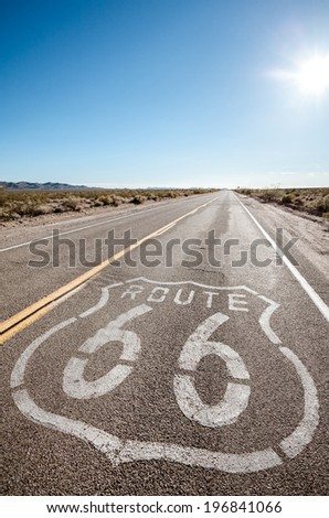 Route 66 road in sunlight - stock photo