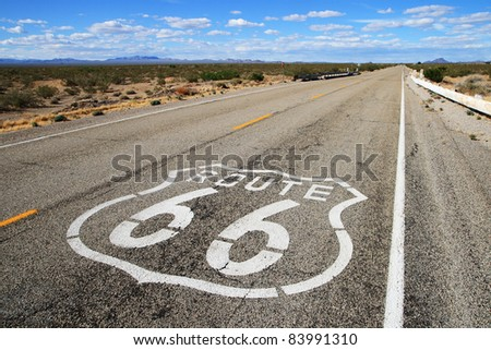 route 66 road leads towards the distant horizon in southern California - stock photo